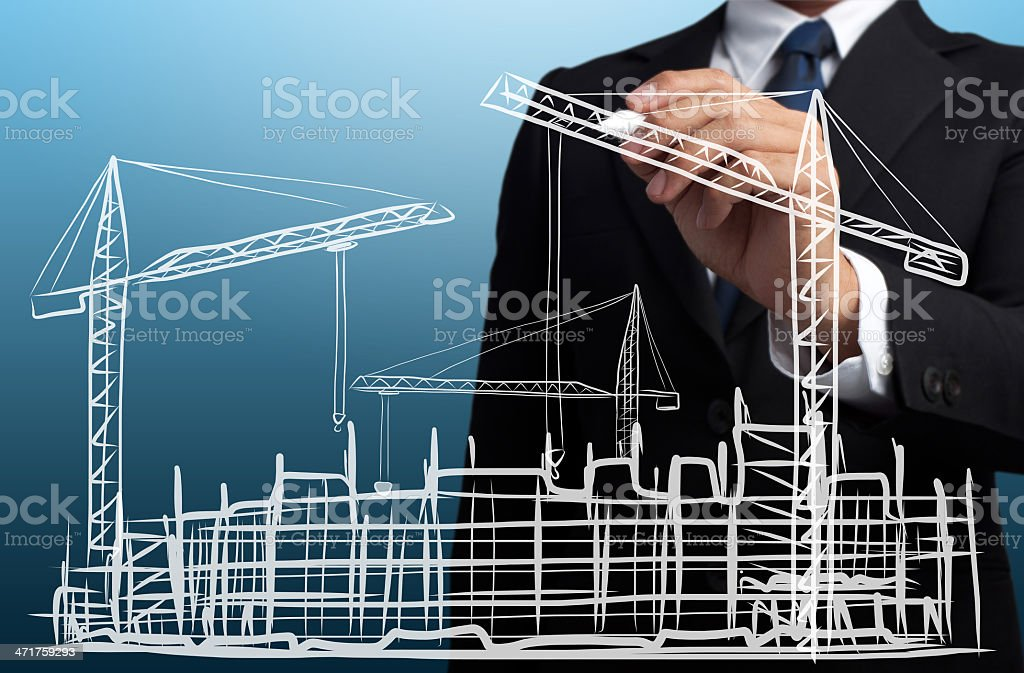 business man drawing construction site stock photo