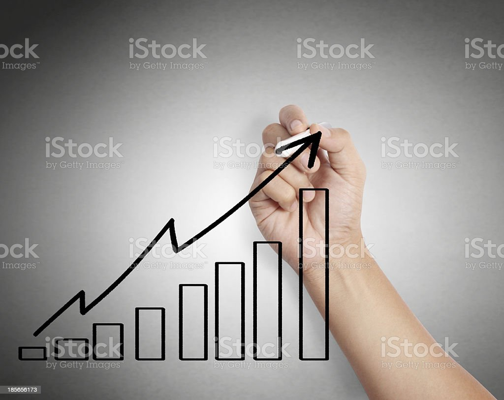 Business man drawing graph royalty-free stock photo
