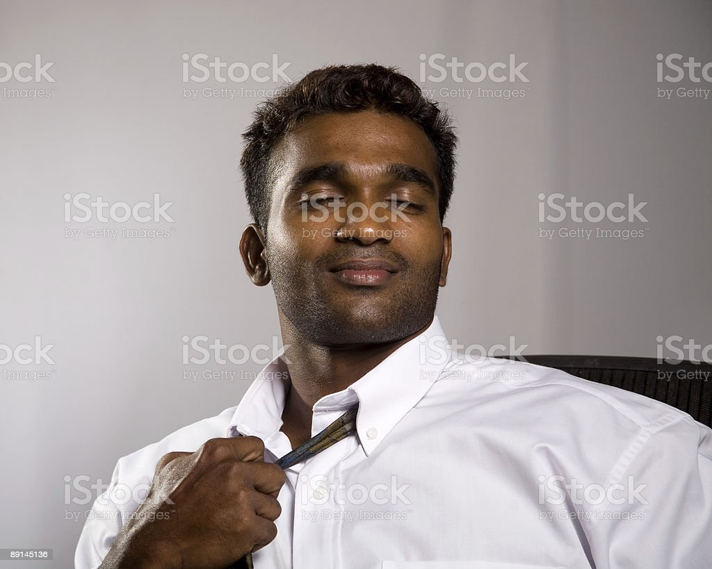 business man dreaming at the end of a long day. stock photo