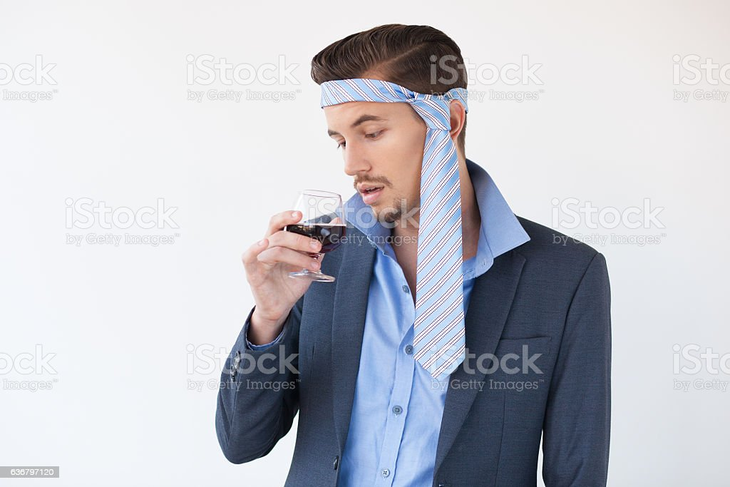 Business Man Drinking Wine with Tie on Head stock photo