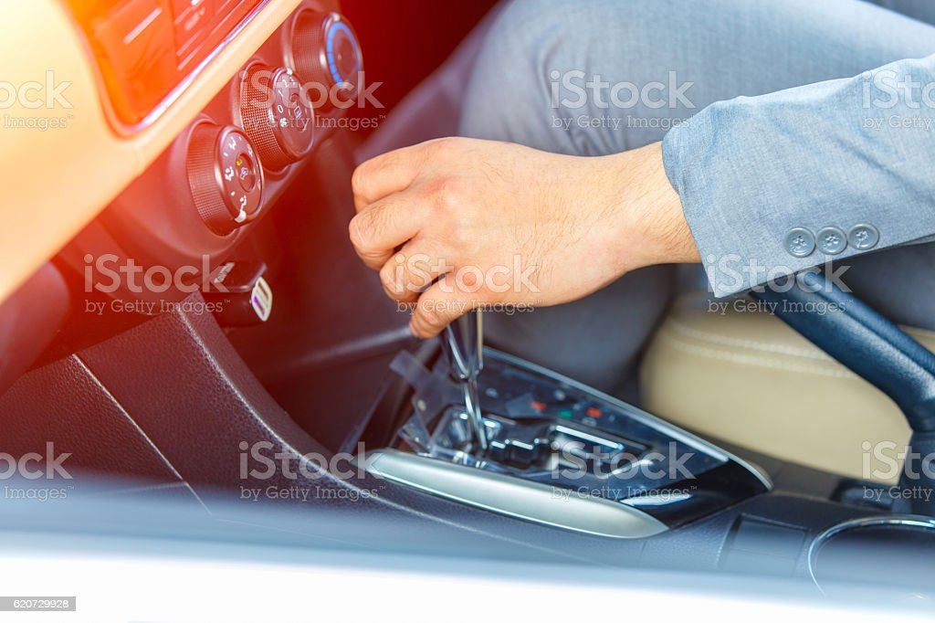 Business man driver hand shifting the gear stick stock photo
