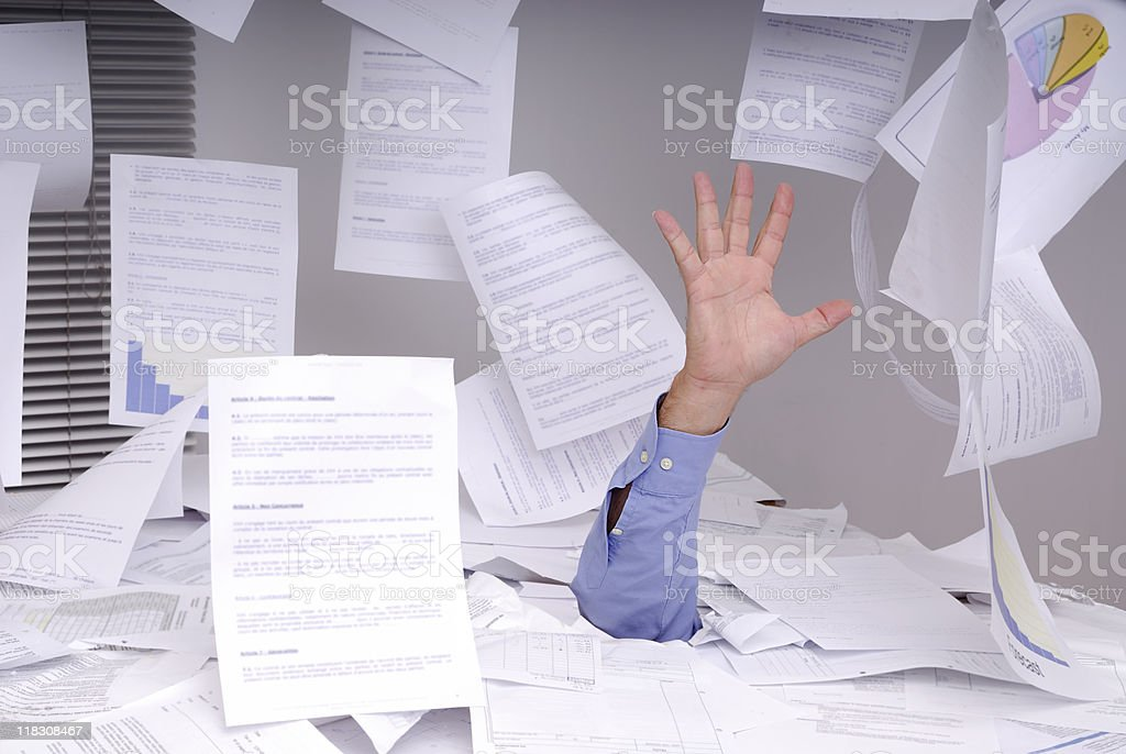 Business man drowning in paperwork stock photo