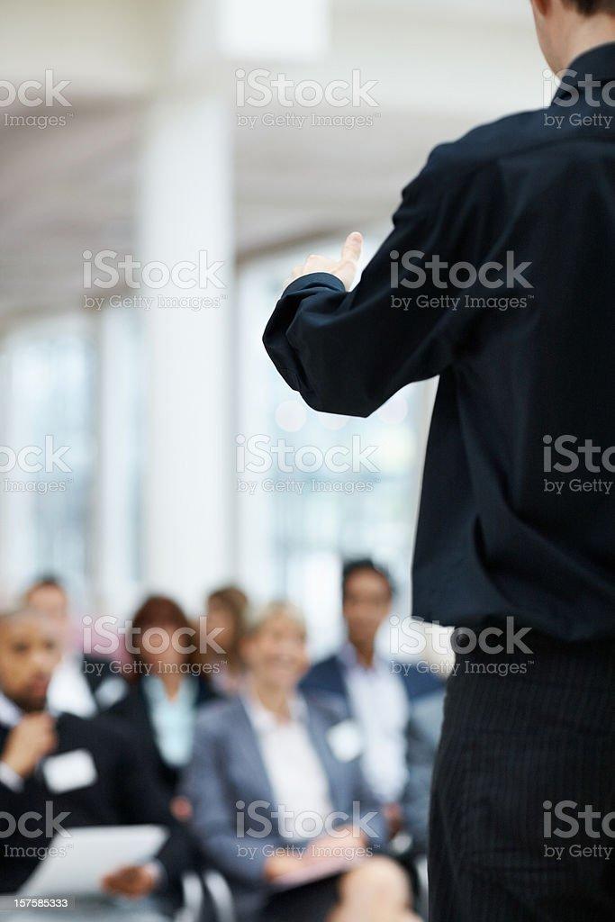 Business man during his speech at seminar royalty-free stock photo