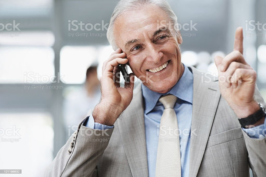 Business man enjoying a conversation on cellphone royalty-free stock photo
