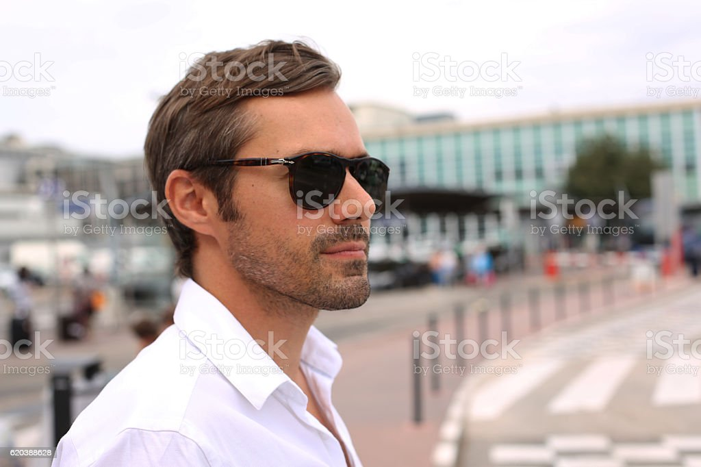 Business man expects a taxi at the airport stock photo