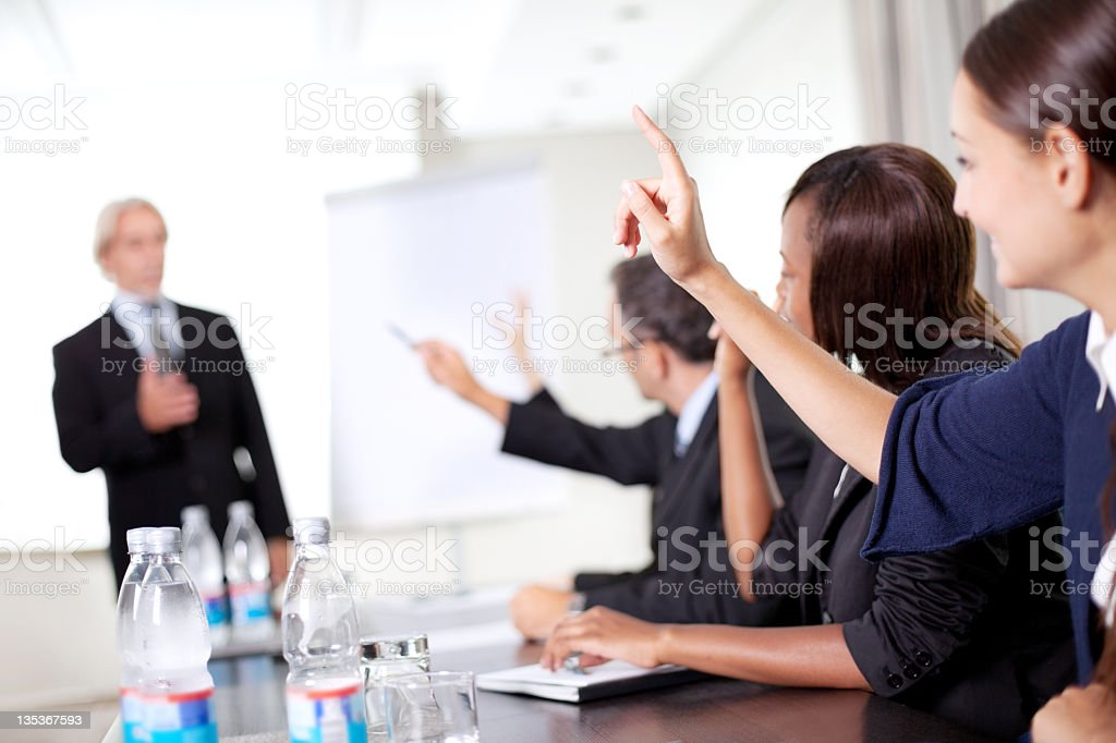 Business man explaining to his team royalty-free stock photo