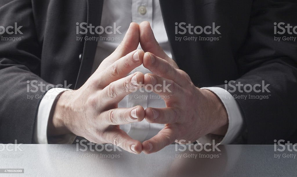 business man explaining with hand gestures royalty-free stock photo