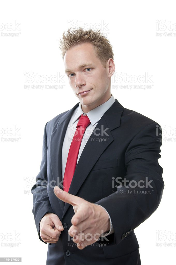 A business man extending his hand for a handshake stock photo
