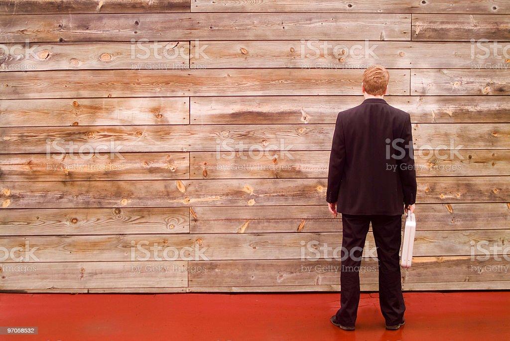business man facing a wall stock photo