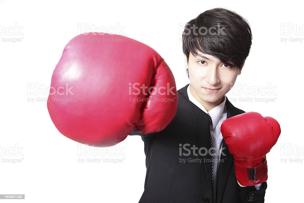 Business man fighting with boxing gloves royalty-free stock photo