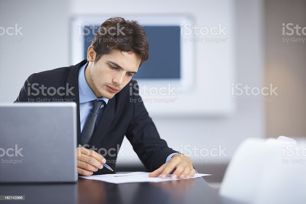 Business man filling out paper on desk in an office royalty-free stock photo