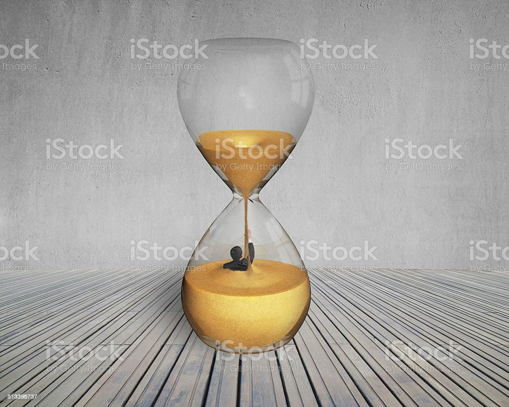 business man flooded in hourglass stock photo