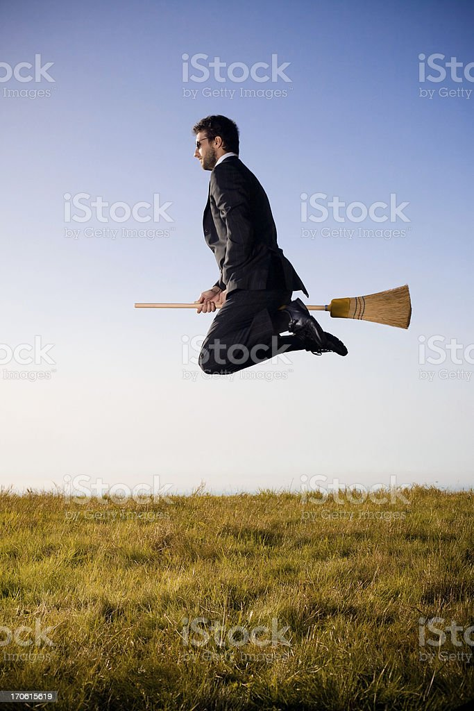 business man flying on broom royalty-free stock photo