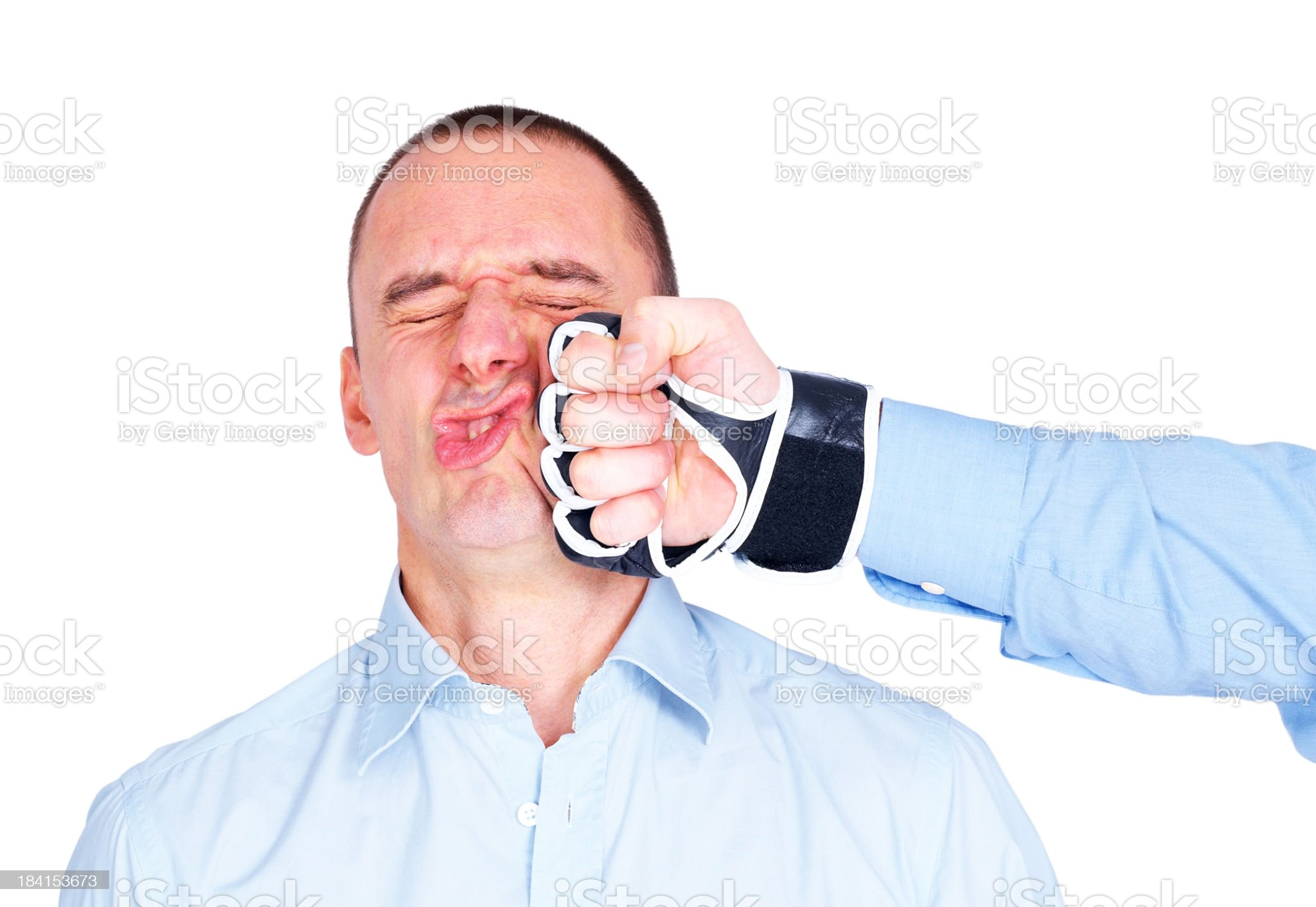 Business man getting punched on his face royalty-free stock photo