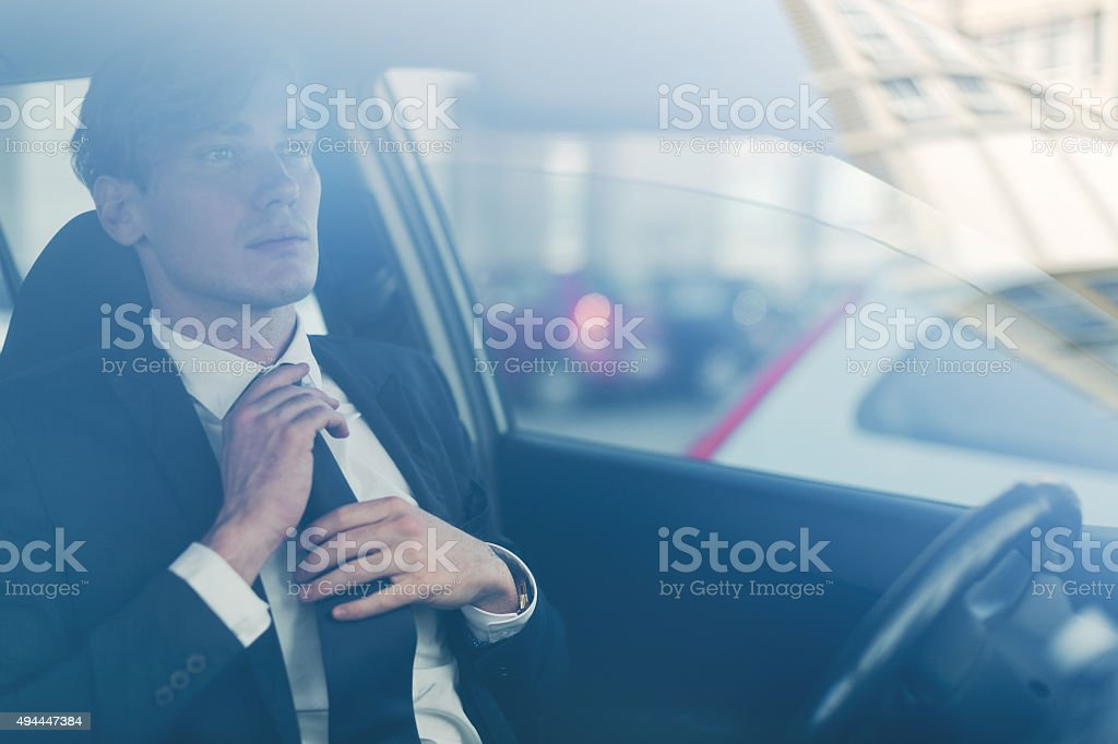 Business man getting ready inside a car stock photo