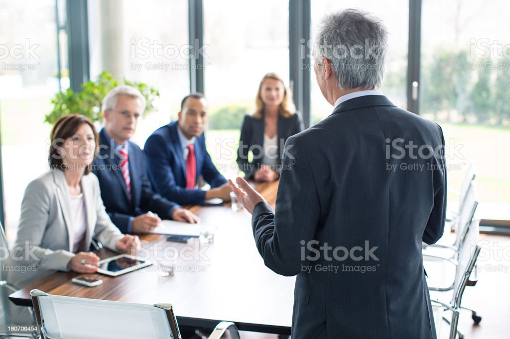 Business man giving a presentation stock photo