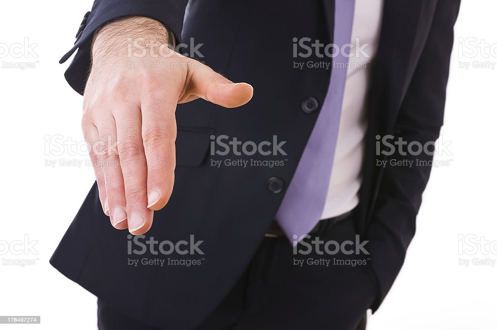 Business man giving hand. royalty-free stock photo