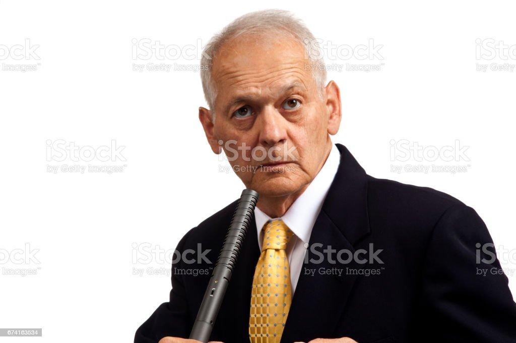 Business Man Glaring, holding microphone. stock photo