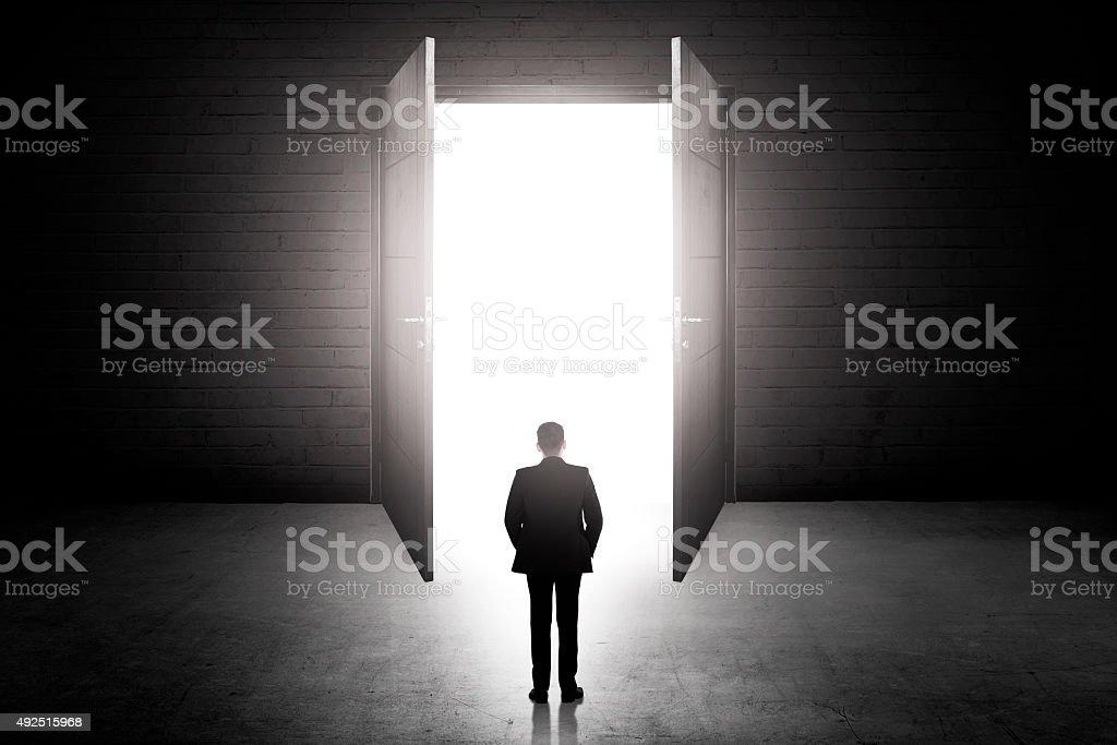 Business man going to the open door stock photo