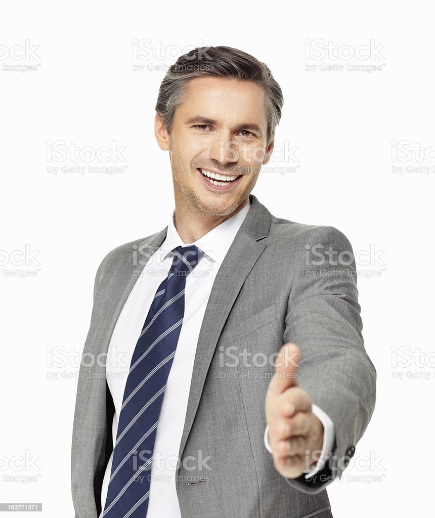 Business man greeting you with handshake royalty-free stock photo
