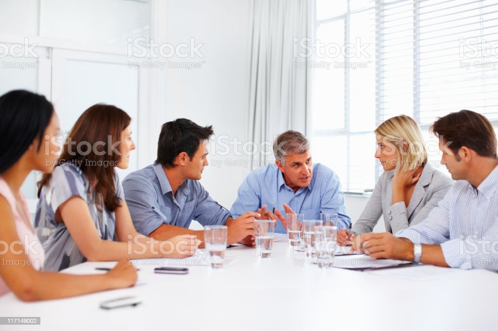 Business man guiding team in meeting royalty-free stock photo
