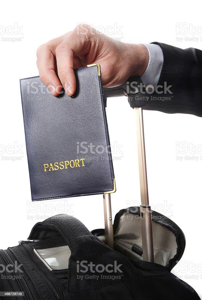 business man hand close up holding passport stock photo