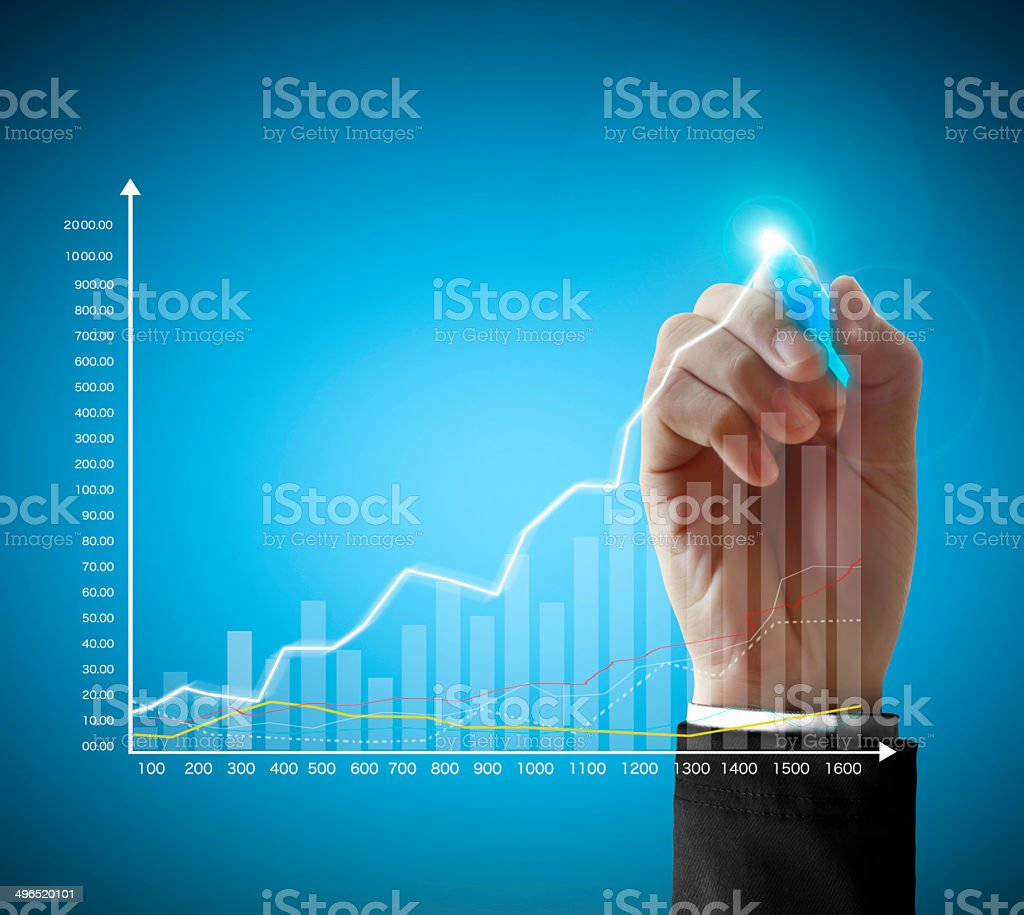 Business man hand drawing graph stock photo