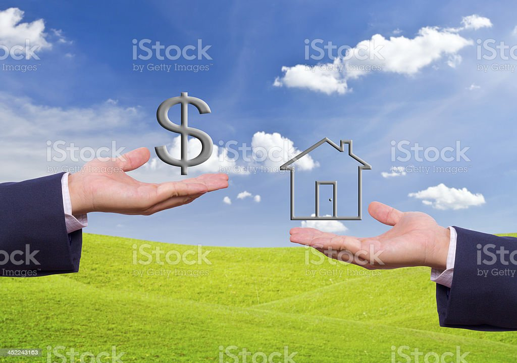 business man hand exchange dollar sign and house icon royalty-free stock photo