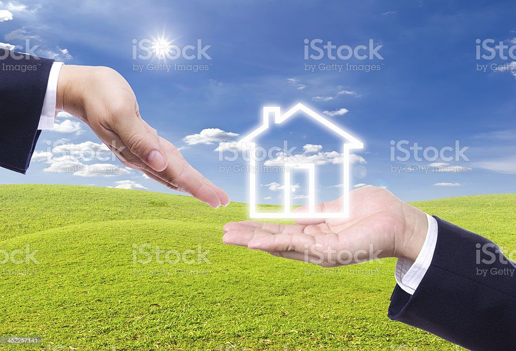 business man hand giving house icon royalty-free stock photo