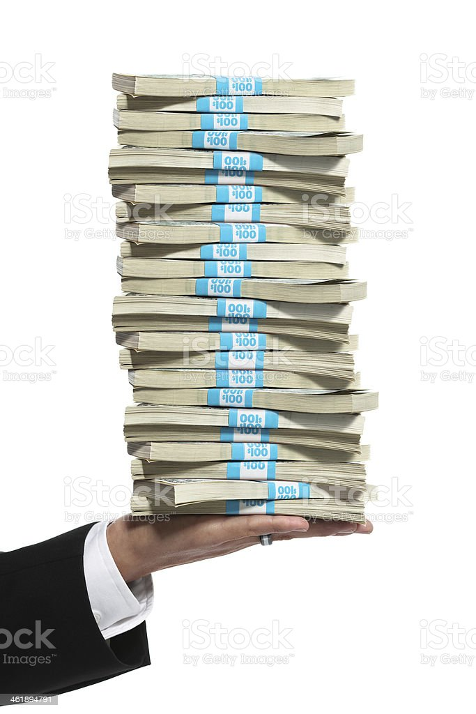 Business man hand holding a tall stack of money stock photo