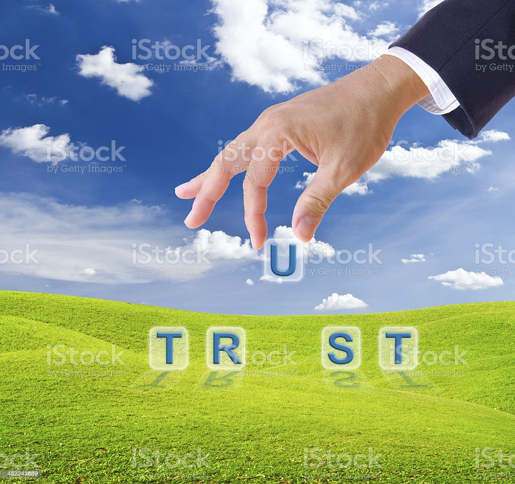 business man hand made trust word buttons royalty-free stock photo