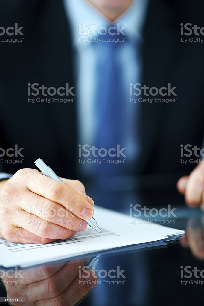Business man hand writing notes at the desk royalty-free stock photo