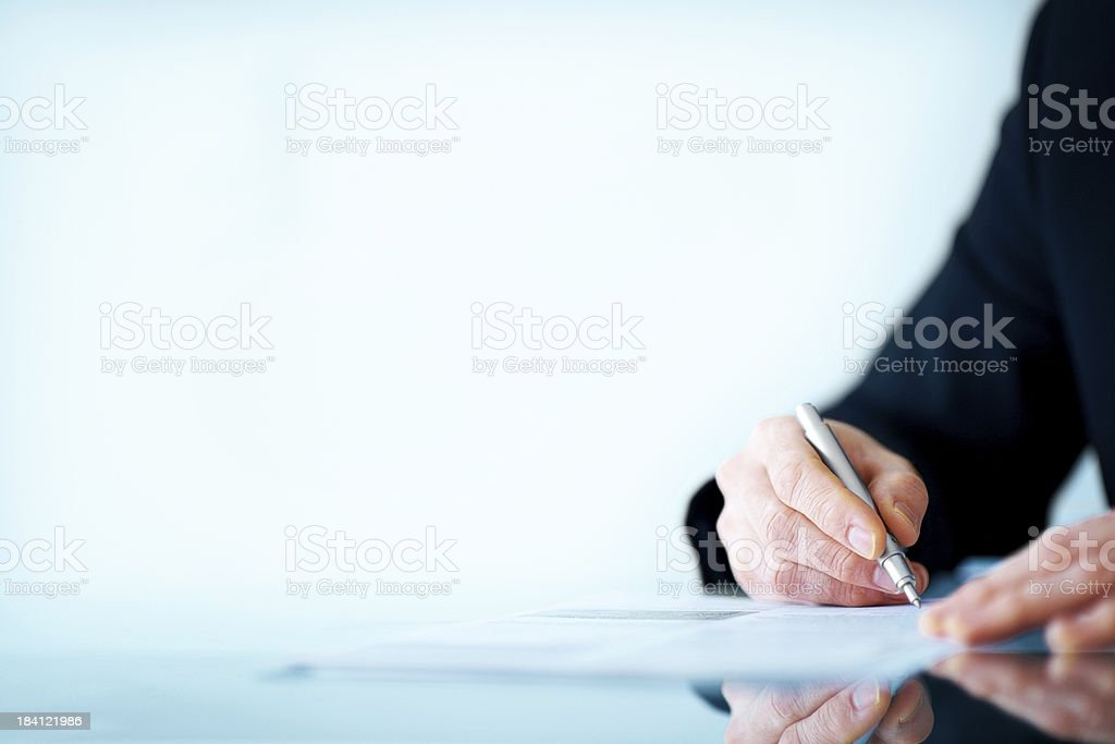 Business man hand writing on paper - Copyspace royalty-free stock photo