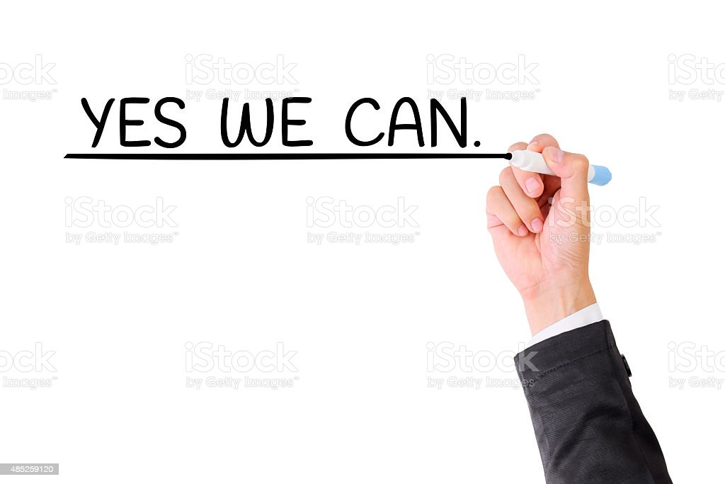YES WE CAN ,Business man hand writing on visual screen. stock photo