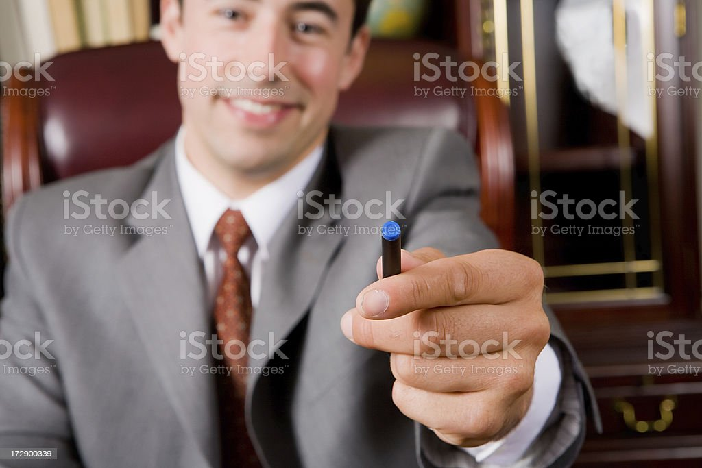 business man handing over a pen royalty-free stock photo