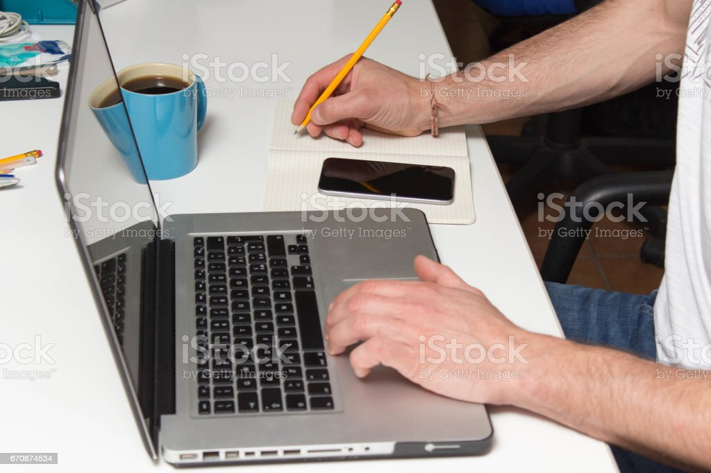 Business man hands using laptop and smart phone on desk stock photo