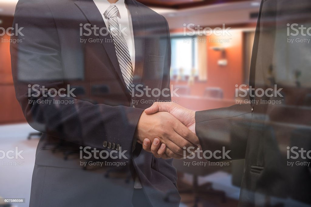Business Man Handshake Investment Agreements And Blurred Meetin