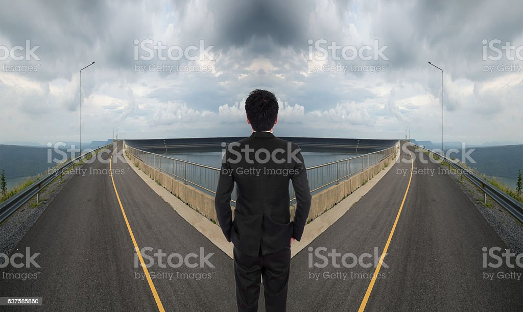 business man has to decide between two way stock photo