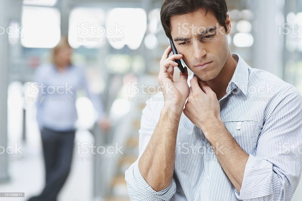 Business man having a serious talk over the cellphone royalty-free stock photo