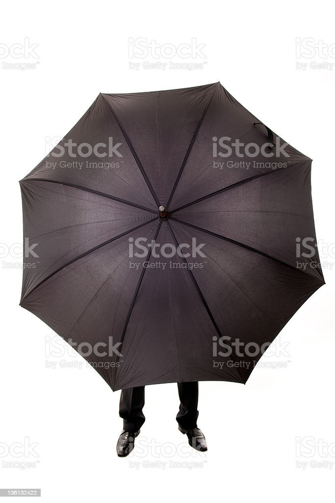 Business man hidden in umbrella royalty-free stock photo