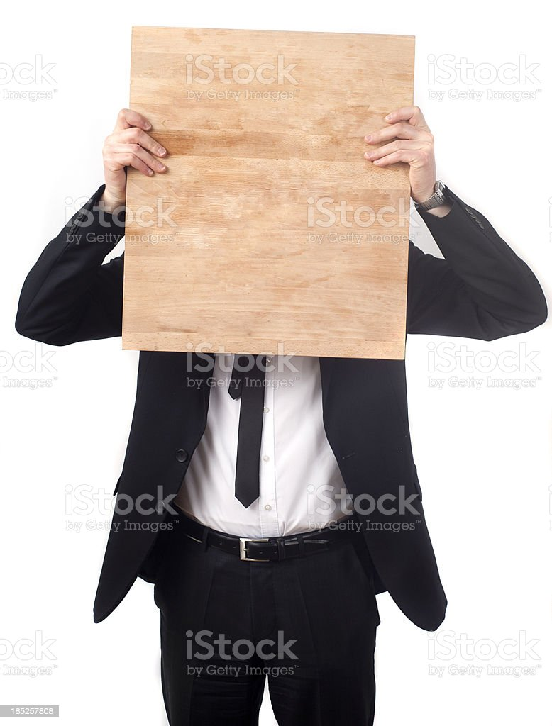 Business man hiding behind wood royalty-free stock photo