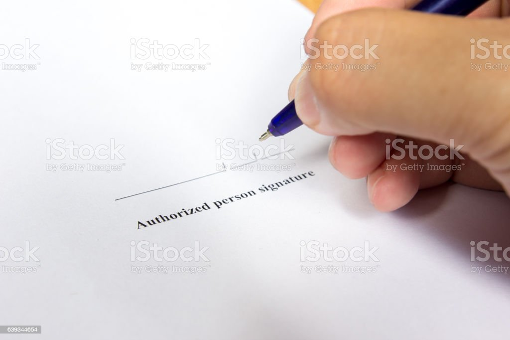 Business man hold pen for sign in authorization signature stock photo