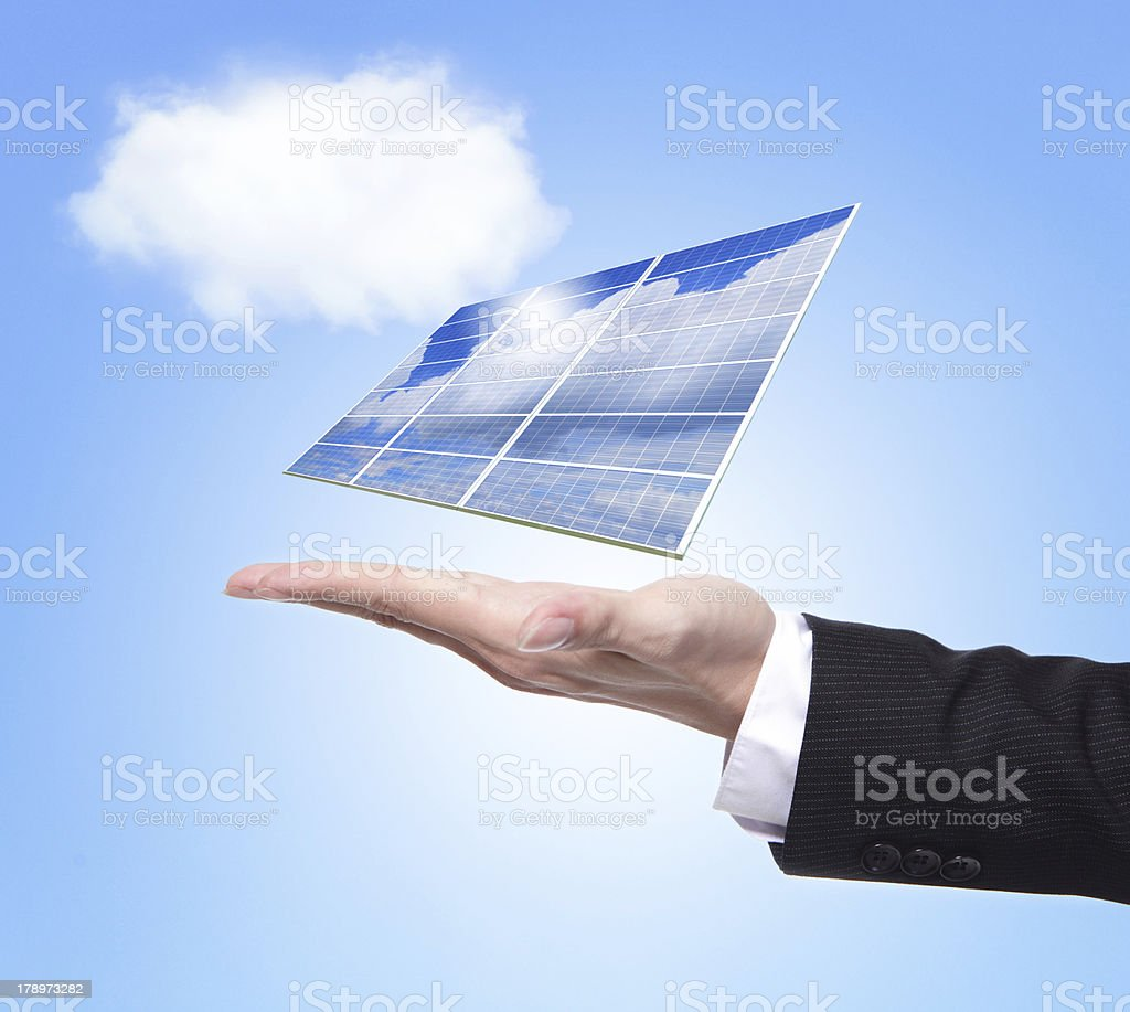 Business man hold solar panel royalty-free stock photo