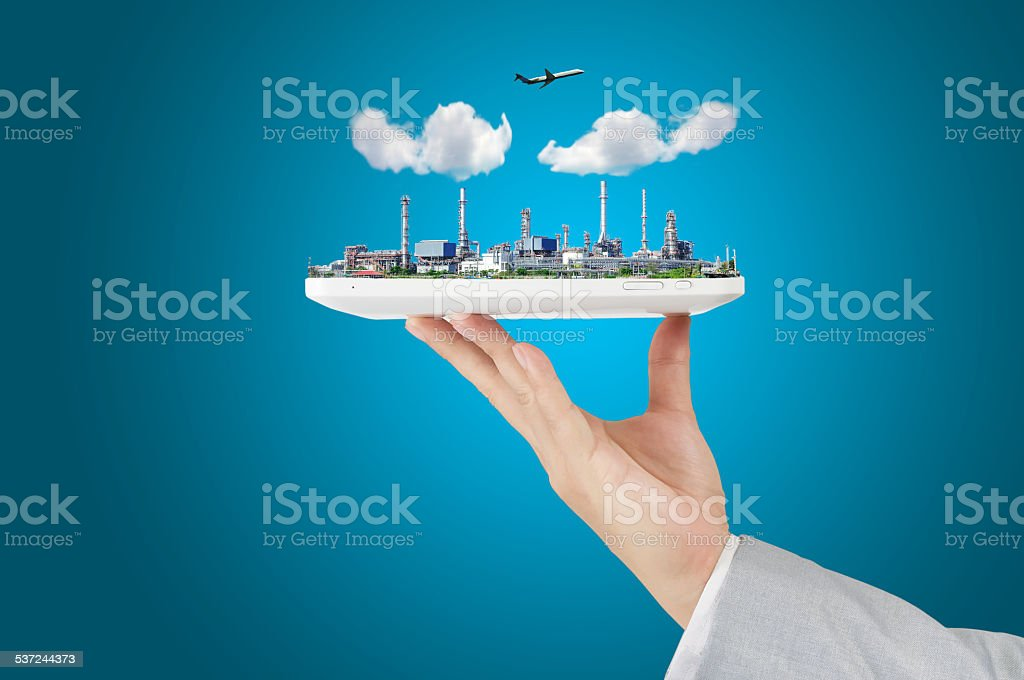 Business man hold Tablet PC with Oil refinery Plant stock photo