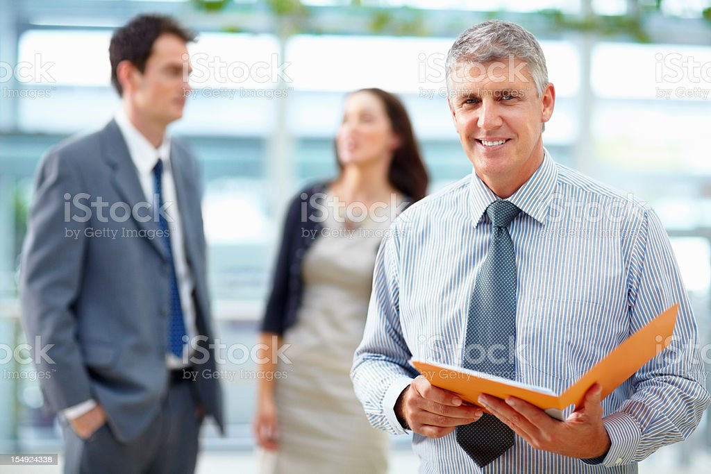 Business man holding a file royalty-free stock photo
