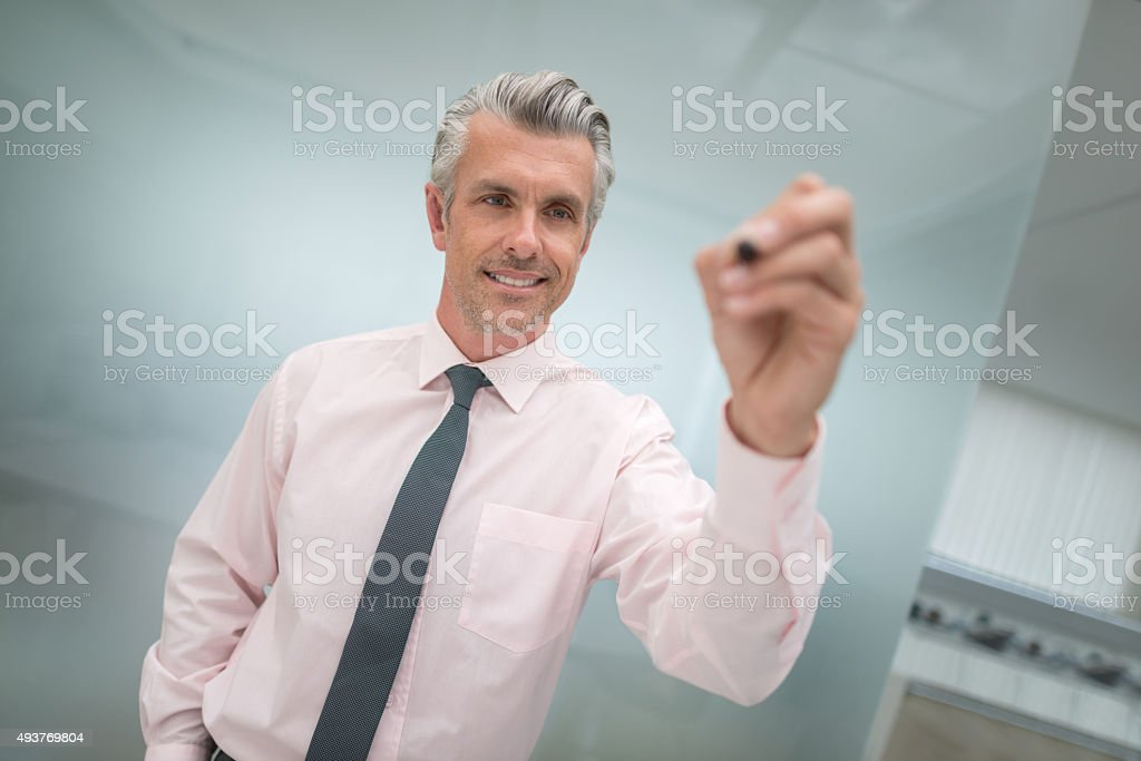 Business man holding a pen stock photo