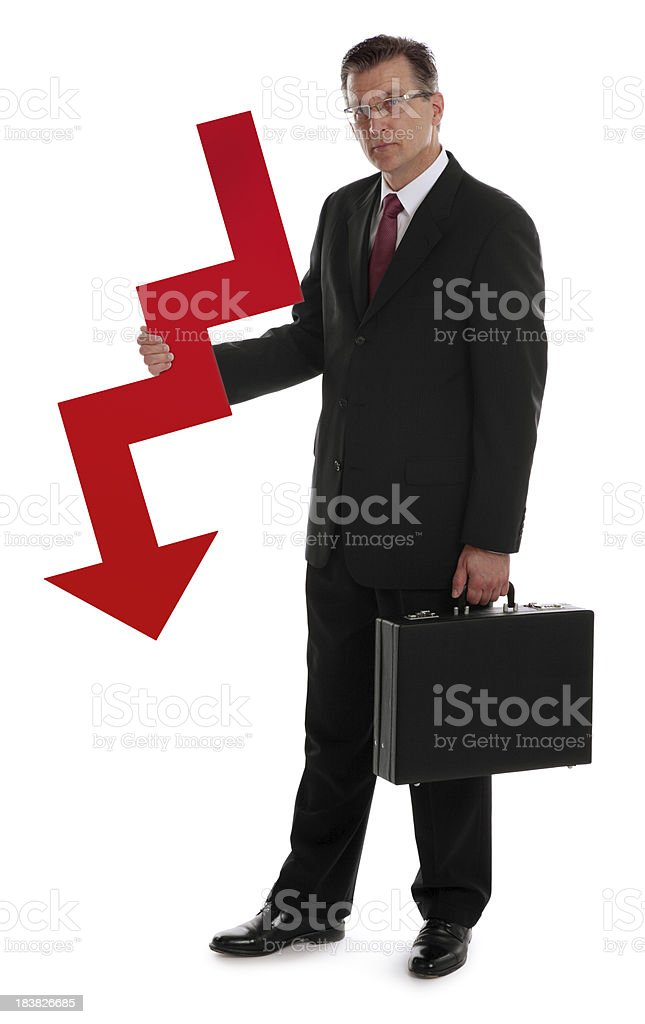 Business Man Holding a Red Down Arrow stock photo