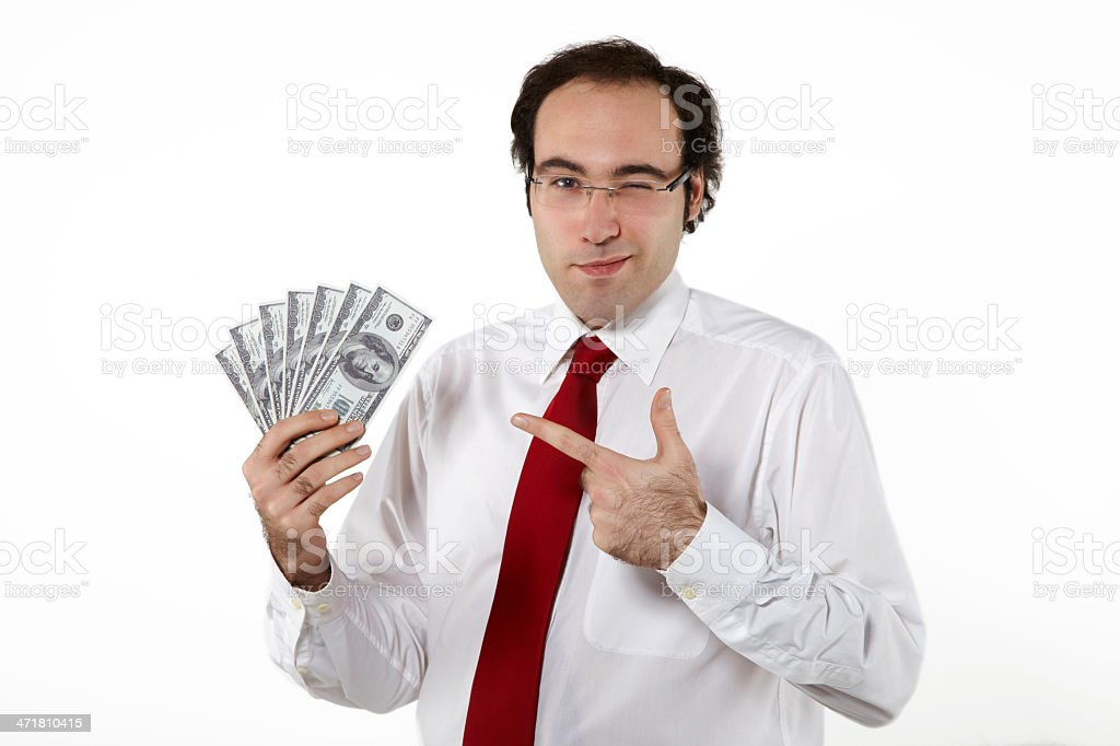 Business man holding and pointing dollars royalty-free stock photo