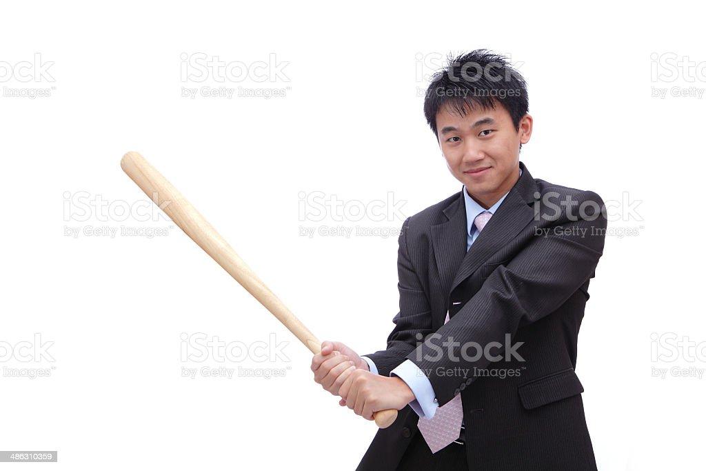 Business man holding baseball bat royalty-free stock photo
