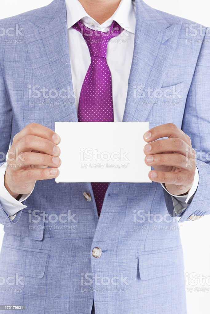 Business man holding blank card stock photo